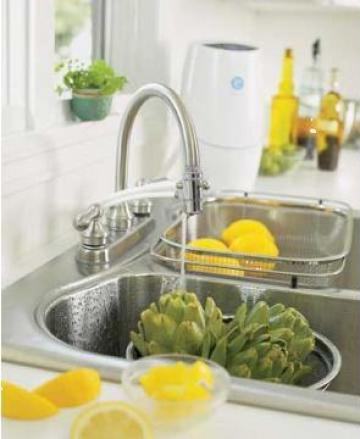 Sistem tratare apa cu filtru de carbon activ si UV de la Sc. Ozohanici Srl.