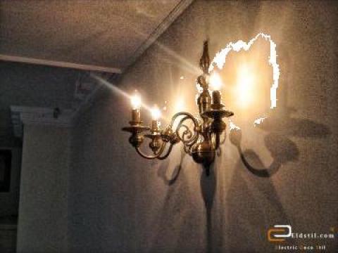 Aplice, candelabre si lustre din alama si fier forjat de la PFA Carstea T. Ion