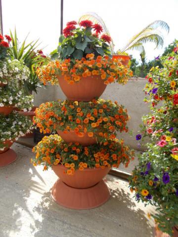 Servicii de confectionare cupe flori de la Sc Fabrica De Flori Natura Srl